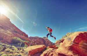 man person jumping desert